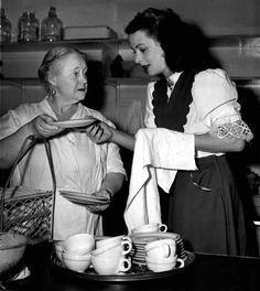 Mary Gordon and Hedy Lamarr do dishes in the kitchen of the Hollywood Canteen, November, 1943.