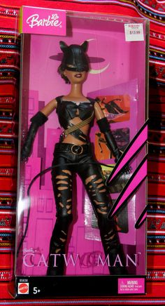 Catwoman by Barbie / Mattel, 2004. Setting aside the fact that the Halle Berry movie on which this is based was one of the worst received comic book films ever (IMdb users give it a 3.2/10 - even worse than Batman & Robin of 1997), the idea of this torn-spandex, whips & chains hussy as a toy for little girls is clearly a winner!
