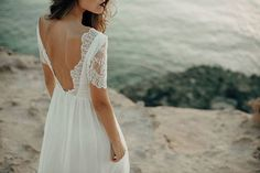 Luna Bride Beach Wedding Dress. The Luna Beach dress is a true Goddess dress, delicate, floaty, feminine and free. With a lovely fitted Chantilly lace top and sumptuous organic peace silk floaty skirt. Featuring a stunning low v back with beautiful scalloped Chantilly lace detailing