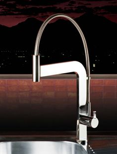 This really cool kitchen faucet from Webert Italian Design which uses a magnetic clasp to hold the pull down head in place, while making it easily movable - ingenious form and function!