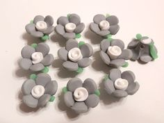 10 Fimo Polymer Clay Gray Flowers Fimo Beads 17mm. $4.99, via Etsy.