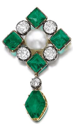 An antique natural pearl, emerald and diamond brooch, late 19th century. Set with a button shaped natural pearl measuring 11.73 x 10.92 x 8.19mm, square-cut emeralds and cushion-shaped diamonds, supporting a circular-cut diamond and a kite-shaped emerald. #antique #brooch