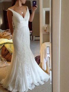 Gorgeous dress but why is she doing an iPhone selfy? Shouldn't there be people for that.