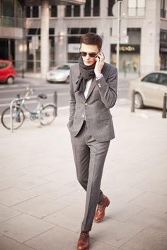 Impeccably tailored grey suit with brown shoes.