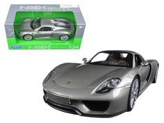 Porsche 918 Spyder Silver Closed Roof 1/24 Diecast Model Car by Welly - Brand new 1:24 scale diecast model car of Porsche 918 Spyder Silver Closed Roof die cast car model by Welly. Brand new box. Rubber tires. Has opening doors. Made of diecast with some plastic parts. Detailed interior, exterior. Dimensions approximately L-8, W-3.5, H-3 inches. Please note that manufacturer may change packing box at any time. Product will stay exactly the same.-Weight: 2. Height: 5.5. Width: 11. Box Weight…