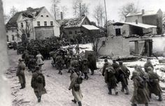 Soviet soldiers moving through a German town on the outskirts of Konigsberg WW2