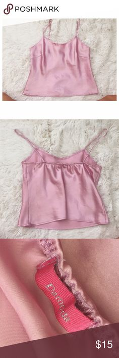 Light Pink Silky Cami similar to the Brandy Melville silky tops. listed as Brandy for visibility. purchased this at a thrift store on melrose. there is no size on the tag but this would fit xs/s :) beautiful dusty rose / peony color Brandy Melville Tops