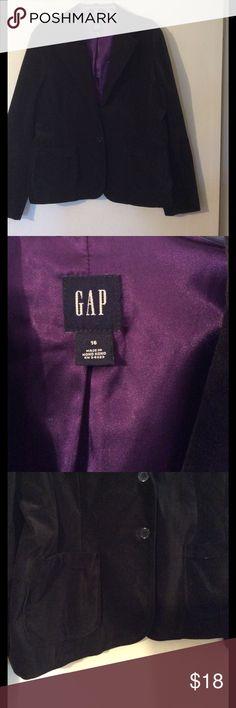 "Black velvet blazer Single breasted black velvet jacket. 2 front buttons, 3 sleeve buttons. Fully lined in purple satin. 2 front pockets. Back slit. 21"" from armpit to armpit, 24 1/2"" from shoulder to hem, 24 1/2"" sleeves. GAP Jackets & Coats Blazers"
