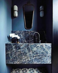 Absolutely marble-ous An unbelievably elegant blue powder room design featuring different marbles and blue tones.