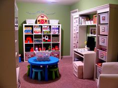 Functional playroom put together by IKEA's Trofast storage system for building shelves and cubbies, mixing and matching the different sizes to create a whole wall storage for $100.