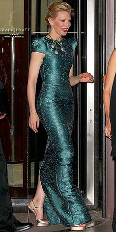 CATE BLANCHETT We'd love to see how Cate packed for this trip. She breaks out another major gown for the Chopard Trophy event: a floor-skimming emerald-green design with allover metallic threading and structured cap sleeves, plus a floral statement necklace.