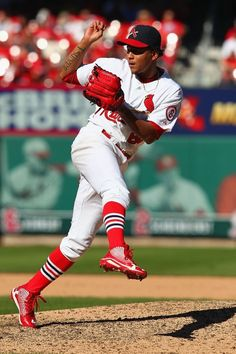 Reliever Carlos Martinez pitches against the Chicago Cubs in the eighth inning. Cards won 4-0. 9-29-13