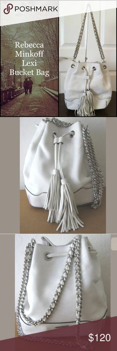 """Rebecca Minkoff LEXI Bucket Bag Absolutely stunning (winter) white leather Lexi bucket bag from Rebecca Minkoff.  Double silver chain with leather woven strap. Tasseled drawstring closure with a magnetic snap. Interior has 2 open pockets on one side and a zippered pocket and a card slot on the opposite side.  Very, very faint wear pictured on draw string closure and bottom bag. Otherwise in immaculate condition! I rate 9/10!! Still smells new! Dustbag not included. 🌀11 """" deep Base 8 & 3/4""""…"""