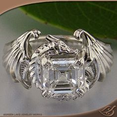 Dragon wedding ring!    I have found the perfect ring! If only it were a round stone! Or moonstone!