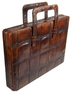 An exclusively crafted briefcase , elegant men -essentials !  Find more on: http://www.luxuryproducts.pl/p,skorzana_teczka_na_macbooka_i_dokumenty_z_krokodyla,65218,760.html