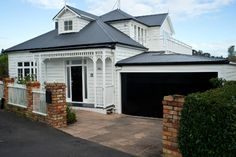 Charcoal grey Colorbond roof compliments the white exterior of this lovely property. #colorbond #roofing