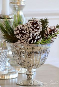 flocked pinecones in mercury glass with pine sprigs