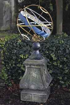 A carved free stone armillary sundial  Netherlandish, first half 18th Century, the sphere of later date  158 cm. high x 46 cm. wide x 46 cm. deep; the sphere 60 cm.
