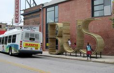 Playful urban design. A Baltimore bus stop that doubles as a giant typographic sculpture.  So now we know. The coolest bus stop in the world is in Baltimore.