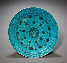 """Turquoise blue dish, c. 1600; Caucasus or northern Iran; fritware with underglaze-painted design in black slip (""""Kubachi"""" ware) 