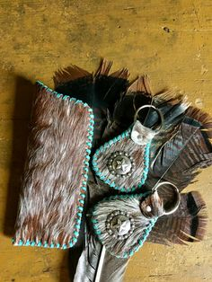 A hair on hide glasses case stitched and lined in turquoise with two matching key rings. gowestdesigns.us