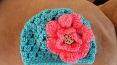 Check out this item in my Etsy shop https://www.etsy.com/listing/223959162/crochet-teal-with-coral-flower-hat-for
