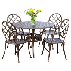 The perfect addition to your patio or three-season porch decor, this charming dining set features a bistro-inspired design and an antique copper finish.