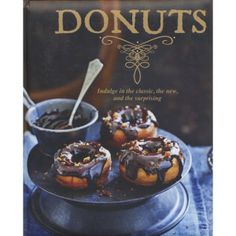 There is a reason you can find donuts in most supermarkets, convenience stores and coffee shops - they are delicious. Make every day extra sweet with homemade donuts. Dipped in chocolate, filled with cream, topped with nuts or simply dusted with sugar, you will love your homemade donut and coffee in the morning. Over 30 donut recipes full of diversity from the humble donut hole to Beignets. Padded hardcover, color photos, 80 pages, ©2013.