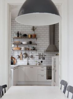 I like this all white kitchen with the metro tiles going up all the way to the ceiling. The open shelving adds some extra storage space and extra character. I love the hanging rail for smaller pots and pans and … Continue reading →