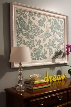 Frame some fabric for a cheap fix to a decorating spot until to find something you really want!  With a used frame, some paint and scrap of fabric could literally be done for less than $15!  From MY HOUSE MY HOME