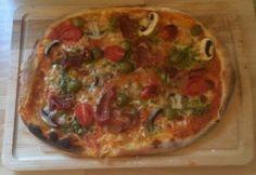 Homemade Pizza http://theproofofthepudding.net/2014/05/16/perfect-homemade-pizza-dough/