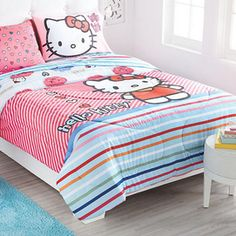 """Create a space that kids love spending time in and make their bedroom a fun, bright and colourful space that will foster great imaginations and bring out creativity. Our HELLO KITTY Collection is a perfect choice for fans of this little feline friend. Featuring bright colours and fun prints in soft microfibre this comforter is sure to make bedtime something to look forward to.  Polyester-cotton microfibre with polyester fill Reverses to a coordinating print 72"""" w. x 87"""" l. Machine wash Hello Kitty Bed, Hello Kitty Collection, Fun Prints, Bedding Collections, Online Furniture, Decoration, Mattress, Comforters, Blanket"""