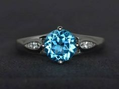 Round cut blue topaz ring solitaire ring engagement ring 925 sterling silver #Affinity Blue Topaz Ring, Blue Sapphire Rings, Blue Rings, Round Cut Engagement Rings, Ring Engagement, Blue Gemstones, Promise Rings For Her, Sterling Silver Rings, Gemstone Rings