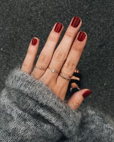 red nails / manicure / gold rings / dainty jewelry