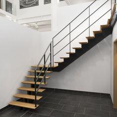 Een trap met centrale boom kopen? De mooiste design trappen vindt u bij Trappen Smet