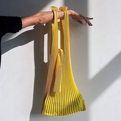 Yellow lightweight pleated bag made from biodegradable corn based PLA (Polylactic Acid Fiber) Two straps with tie closure To maintain pleats, empty the bag after use Hand wash, do not tumble dry 22 x 30 inches Made in Fukui, Japan From KNA Plus Lv Bags, Purses And Bags, Look Fashion, Fashion Bags, Diy Vetement, Clutch, Mellow Yellow, Biodegradable Products, Diy Clothes