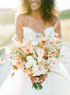 Peach and ivory wedding bouquet: http://www.stylemepretty.com/2017/04/25/french-blue-and-cherry-blossom-spring-wedding-inspiration/ Photography: Rebecca Yale - http://rebeccayalephotography.com/