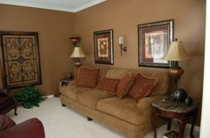 The wall color is Pepper Spice by Behr. FOUND IT!!! This will be my livingroom color!!!