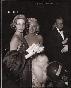 1953: Marilyn Monroe and Lauren Bacall at the premiere of How To Marry A Millionaire.