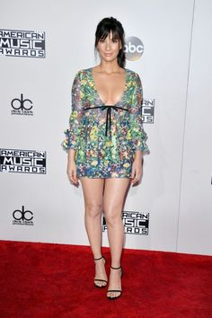 <p>What a combo! Olivia Munn was living on the edge wearing a pretty floral dress that featured both a dangerously short hemline and very low neckline. <em>Photo: Getty Images</em> </p>