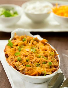 Frito Pie ~ The famous Frito Pie - a generous serving of chili topped with Fritos corn chips and shredded cheddar cheese, then baked until melted and bubbling.