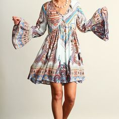 """Paisley Boho Boho Dress with Bell Sleeves. Matching fabric covered buttons on front running half way down. Gorgeous Colors!! This Dress could also be worn as a Tunic. 65% Cotton 35% Polyester. Available in S-M-L.           Length:  S-32"""" /M-32"""" / L- 32 1/2"""". NOTE: All sizes are 2"""" longer on backside. Background color is a pale pale blue. Gorgeous!  Measurement for length is taken from the shoulder seem to the hem. Boutique Dresses Midi"""