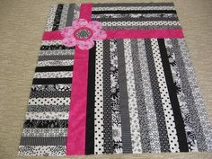 Jelly Roll quilt.love the black & white
