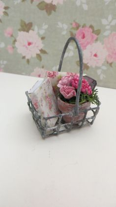 A filled metal basket for the dollhouse by Miniatyrmama on Etsy