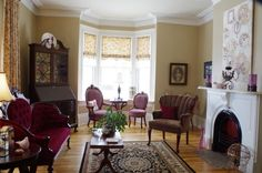 The Parlor, original mercury glass windows, 10 foot ceilings, a mix of antique finds from attics to auctions.