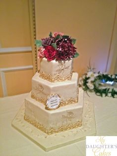 50th Wedding Anniversary Cake in Ivory and Gold with hand painted roses.