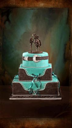 Yep this is def gonna be my cake. Blue my fav color plus cowboy style is perfect....Cowboy wedding cake