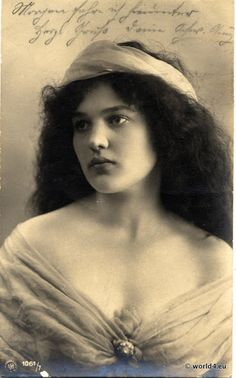 Beautiful old postcard with a picture of a young woman in 1900.  Hair, Fashion from the Art Nouveau period