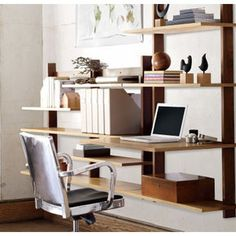 If you're looking to fit a desk with storage into the side of your room, Sticotti shelving is a very stylish solution.