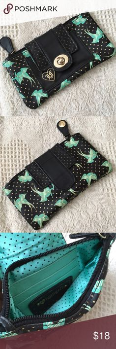 NWOT Loungefly wallet NWOT Loungefly wallet. Black with turquoise birds and gold polka dots. Never used!  Has turnkey lock. Super cute!  Could fit most phones. Double condition with me prior to purchasing-- I might use if not sold soon! Loungefly Bags Wallets